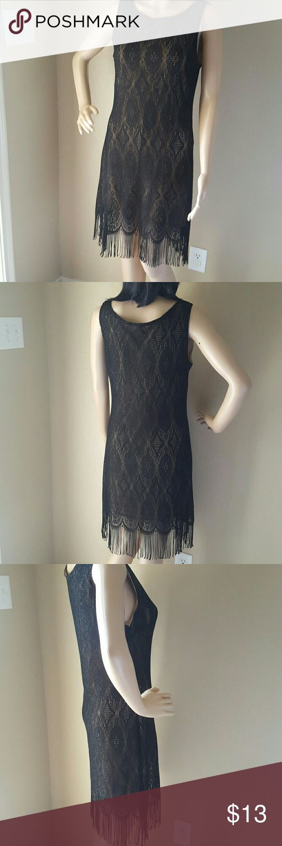 Black Flapper Dress Black lace with fringe hem. Nude sheer lining underneath. Does not have a size tag in it, but I would say it's a size small. Hem on lining coming unraveled. Simple handstitch would fix. Perfect for Roaring 20's theme party or Flapper Girl costume. Opera Dresses Mini