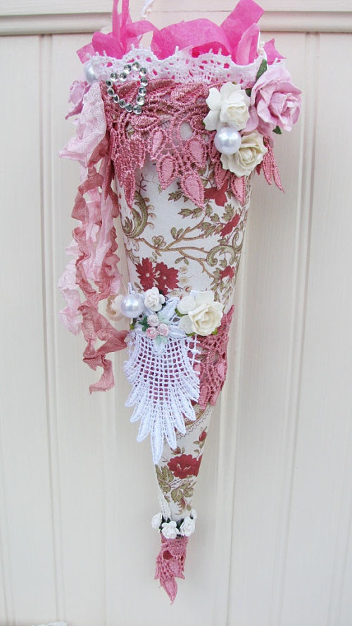 My first Tussie Mussie. Made of heavy cardstock and lots of lace, ribbons and roses.
