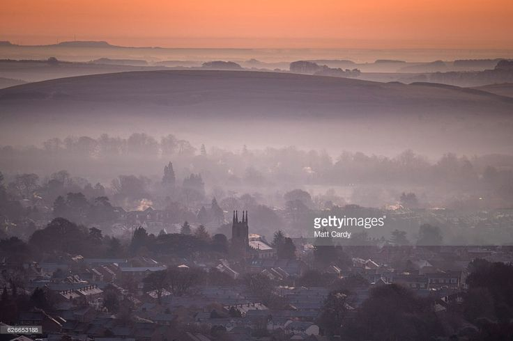 The sun begins to rise over the town of Warminster viewed from the National Trust's Cley Hill, as the country wakes up to sub-zero temperatures, on November 30, 2016 in Wiltshire, England. Sennybridge in Wales recorded the lowest temperature of the season overnight, with the Met Office reporting a low of -9.4C.