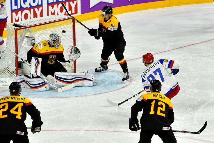 Classy Russia, Canada maintain the pace at ice hockey worlds  -  May 8, 2017:          Russia's forward Vadim Shipachyov scores against Germany's goalkeeper Thomas Greiss the first goal during the Ice Hockey World Championships group A match between Germany and Russia at the LANXESS arena in Cologne, Germany, Monday, May 8, 2017. (AP Photo/Martin Meissner)