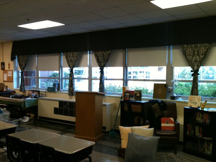High school classroom - window decor and reading nook.  Curtains/valance affixed to ceiling tiles with binder clips :)