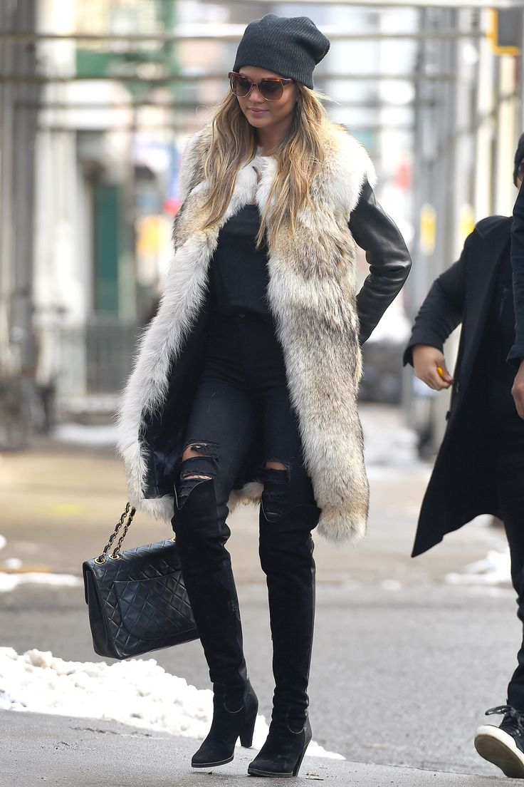 The Takeaway: Ripped jeans and fur vests are perfect pieces all year round.   - HarpersBAZAAR.com