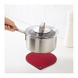 The magnetic trivet adheres to cookware that is suitable for use on induction cooktops. Slip the trivet underneath a pot with magnetic bottom and it hangs on when you lift and carry the pot.