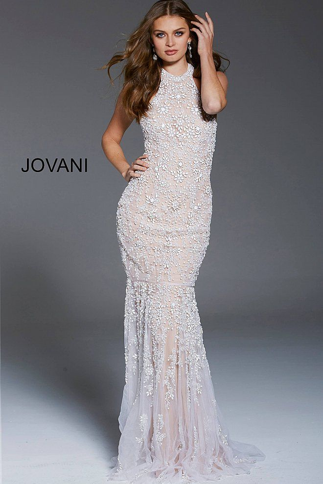 8871cef0d572 Floor length form fitting ivory embellished formal dress with nude underlay  features sleeveless bodice with high