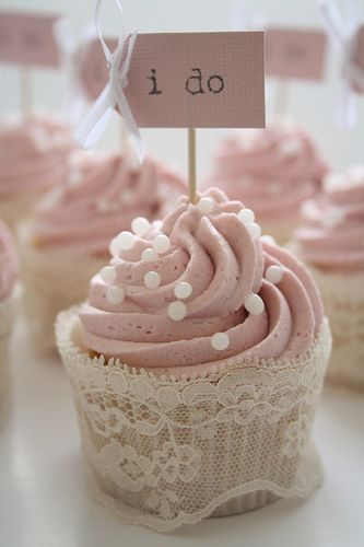 Add lace or ribbon to your plain cupcake wrappers and messages or little pictures on a cocktail stick to bring personality