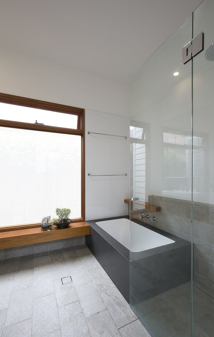 A deep Japanese soaker bath clad in stone. Brooke Aitken Design