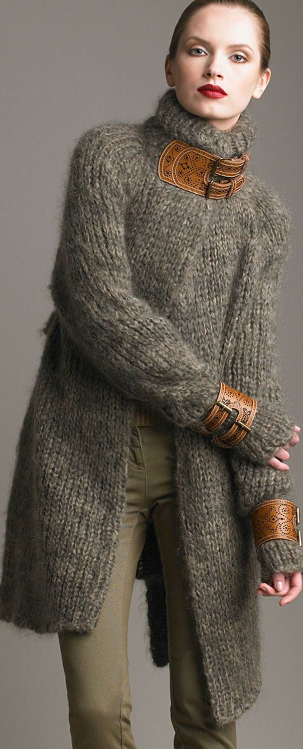 Alexander McQueen: Grey cardigan with leather details in collar and cuffs, olive pants.