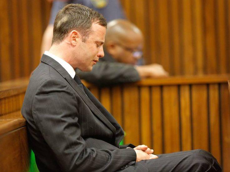 Oscar Pistorius reacts in the dock during the verdict in his murder trial in Pretoria.