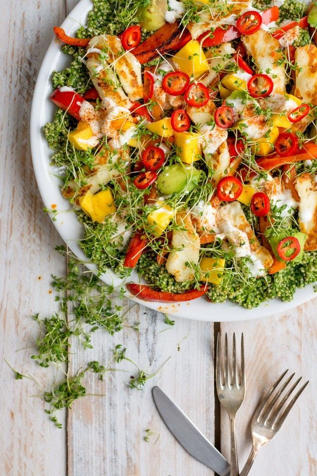 A deliciously fresh halloumi and quinoa salad with all the colours of the rainbow! Herby and zesty, topped with avocado, mango and Halloumi cheese, this salad has everything!