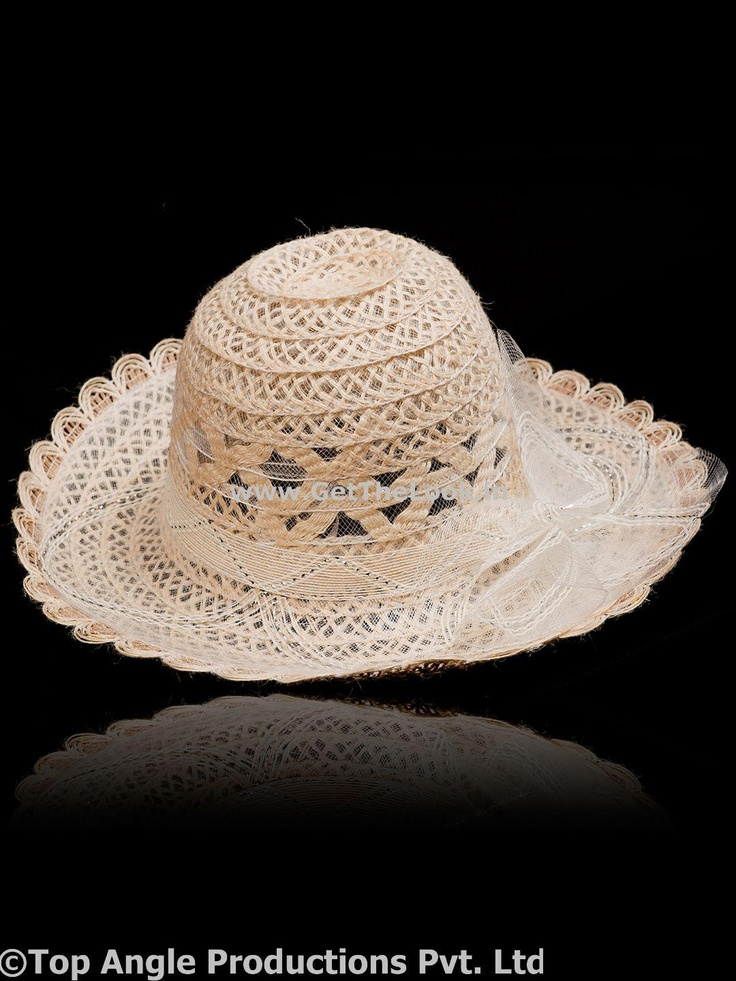 Protect yourself from heat this summers with this beautiful white round hat with a silver thin border that adds grace and style to your look. Cream color is soothing as well as refreshing. So beat the heat with this pretty hat and your charming style.