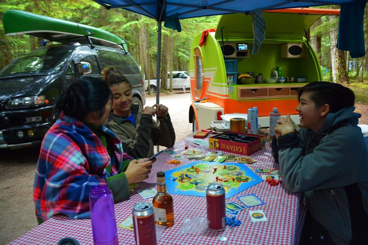 Chilliwack Lake Provincial Park.  Perfect moment playing Catan with my family.  2000 Mitsubishi Delica and Vurv Teardrop Trailer.