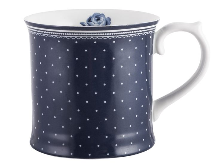 Inspired by the heritage art of Amsterdam, this Spot Tankard Mug from the Vintage Indigo collection is a pretty piece from British designer Katie Alice. Capturing the elegance of delftware with a modern twist, delicate white polka dots contrast against a beautiful dark blue canvas. A unique super white porcelain design, this tankard mug features an elegantly curved handle with thumb rest and sweet interior floral detail. Inspired by the delft tiles of Rembrandt's house, Vintage Indigo takes…