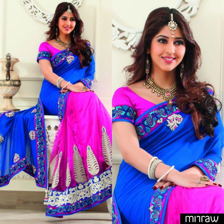 Gorgeous Pink Georgette & Net combo half & half Thread & stone worked designer saree in multi colour border & dark blue thread worked pallu along with pink blouse in multi colour border to give you a posh look