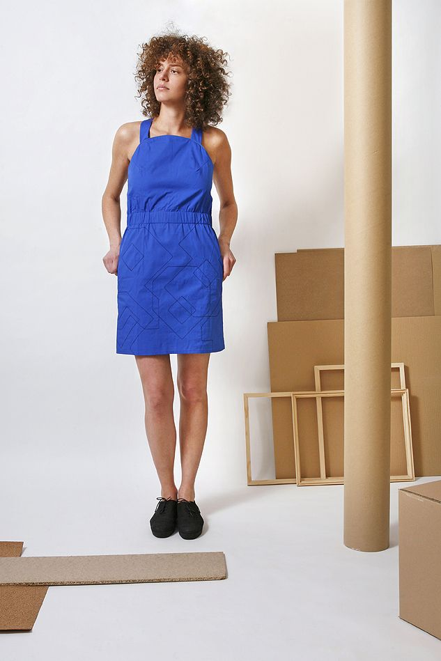 Be yourself in this linen apron dress in blue, with black geometric stitching on the skirt part, from the 2014 S/S collection.