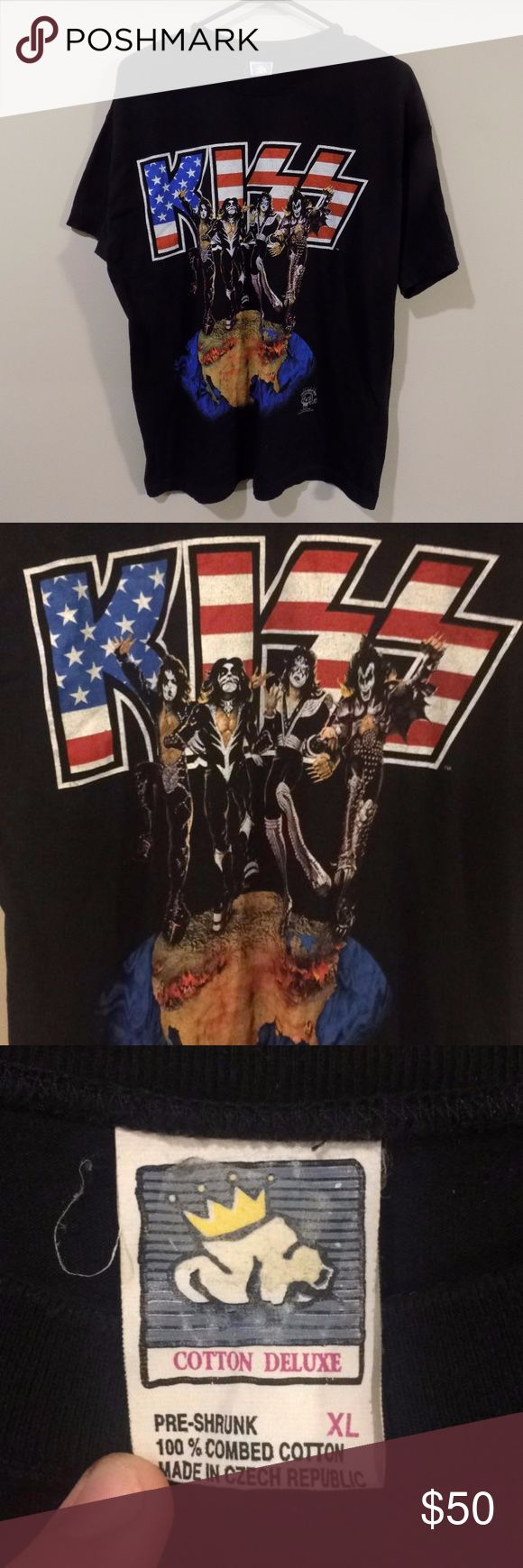Vintage Kiss 1996 Alive/Worldwide Tour Band Tee Vintage Kiss 1996 Alive/Worldwide Tour Band Tee. Incredible vintage piece! Band tees are obviously in style, but what a grail! This shirt has some crazy graphics on it and is still in a 9/10 condition! Very hard piece to find! Actual concert shirt from Kiss 1996 Alive/Worldwide Tour! Vintage Shirts Tees - Short Sleeve