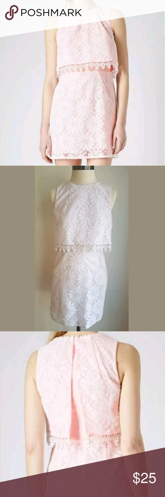 """🇱🇷SALE🇱🇷 TOPSHOP Pale Pink Lace Crop Dress Excellent Condition ~ Smoke Free and Clean ~ ONLY NOTED FLAW: Missing Hook for Hook and Eye At Base Of Neck - See photo ~ No Noted Tears, Stains, Snags, Pulling or Damage.  Pale Pink ~ Floral Lace Overlay ~ 100% Polyester ~ White Crochet Detail ~ Zips Up Back ~ Lined ~ Sleeveless  All Measurements Taken With Garment Lying Flat. All Measurements Are Approximate. Length 33"""" Bust (armpit to armpit) 16"""" Waist (side to side) 14"""" Hips (side to side)…"""