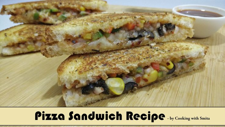 """Pizza Sandwich Recipe in Hindi by Cooking with Smita  Pizza Sandwich Recipe  Pizza Sandwich Recipe made from Bread slice that tastes like Pizza, which will be liked by all. Kids love it too and so it is perfect kids lunch box idea. It is quick to make, and it is very tasty.  Watch my video recipe of """"How to make Pizza Sandwich"""" on YouTube"""