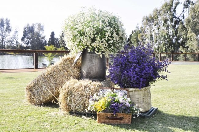 Ceremony decor for a rustic setting the big bunches of flowers add a perfect touch