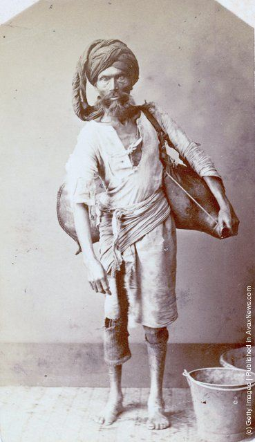 """A water carrier or """"bhisti"""" in India, circa 1870. (Photo by Hulton Archive/Getty Images)"""