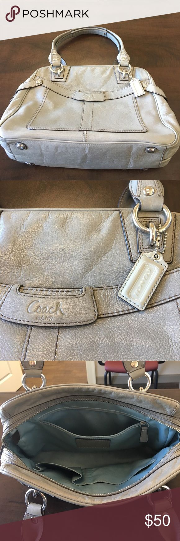 Coach Leather Handbag This well-loved handbag is the perfect shade of gray and the perfect size to hold everything you need to get you through the day! Will fit iPad mini and has both exterior zippered pocket and open pocket, as well as zippered main compartment with zippered pocket and open pockets for a pen and two cell phones. The outer leather is in good shape, but the ice blue lining needs some work and I just don't know how to do that. Includes the Coach badging that came with the bag…