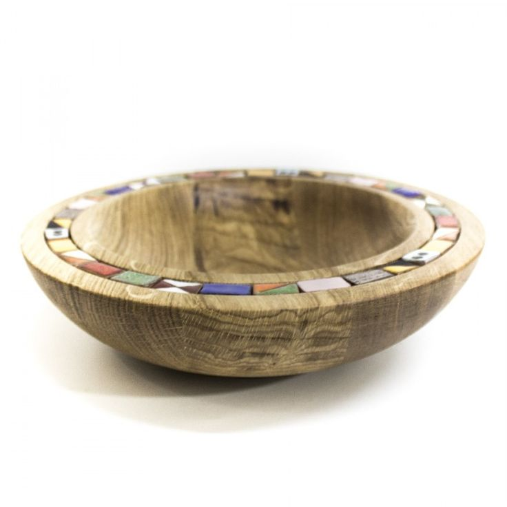 Handmade bowl made from oak and surrounded by tiny ceramic tile.