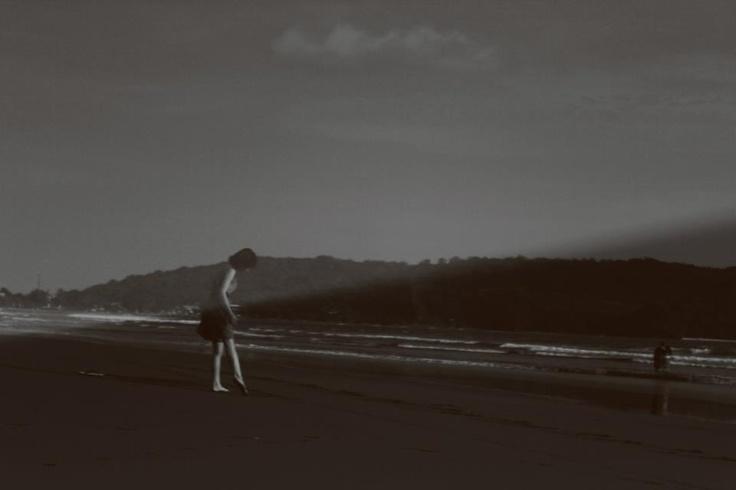 beach dancing by Melina Yasmien