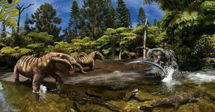"""Um grupo de """"Dicynodon Synapsida"""", da classe dos cordados, encara um antigo """"Archosaurus"""" enquanto ele tenta abocanhar um """"Saurichthys"""". Percebendo o perigo, o """"Chroniosuchus"""" foge pela água rasa."""