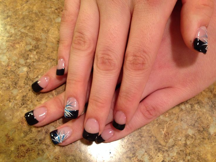 Black French tip nails with flower design.