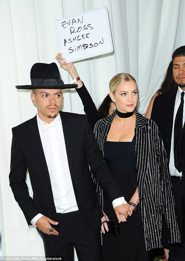 Showing their ID: Ashlee Simpson and Evan Ross were caught in an embarrassing moment when a handler held a sign with their names over their heads as they arrived at Elton John's Academy Awards Viewing Party Sunday