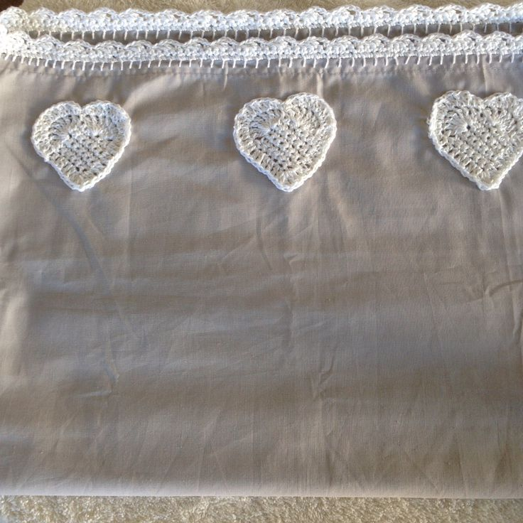 Crochet hearts and edgings on pillow slips.