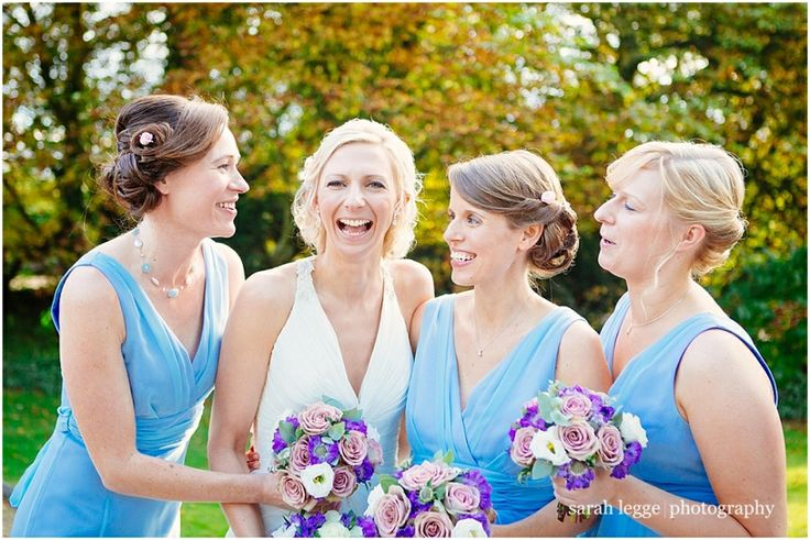 Bridesmaids in two birds dresses