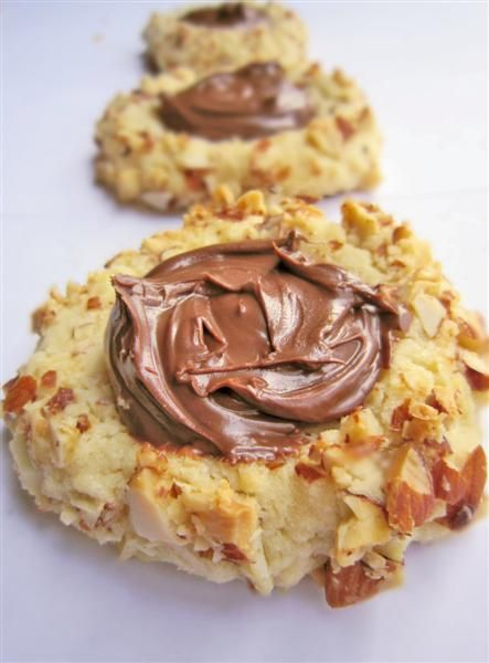 Ferrero Rocher thumbprint cookies! my mom and mother in law would love these!
