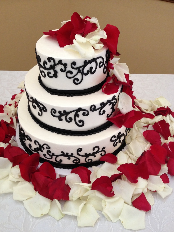Black French Scroll with rose petals wedding Cake I like how the petals are cascading down the side. I'd love it better on square tiers though.