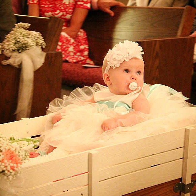 Miss Gracynn in her flower girl wagon.
