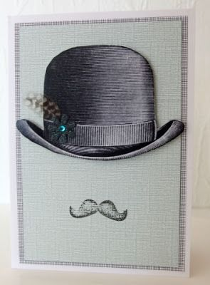 Bowler hat with feather and stamped moustache _Moski