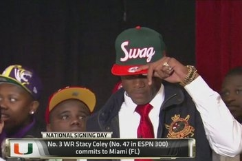 Awesome hat! Stacy Coley signing with the U