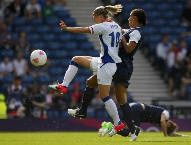 France's Camille Abily (10) fights for the ball with Shannon Boxx of the U.S. during their women's Group G football match at the London 2012 Olympic Games at Hampden Park in Glasgow, Scotland July 25, 2012.