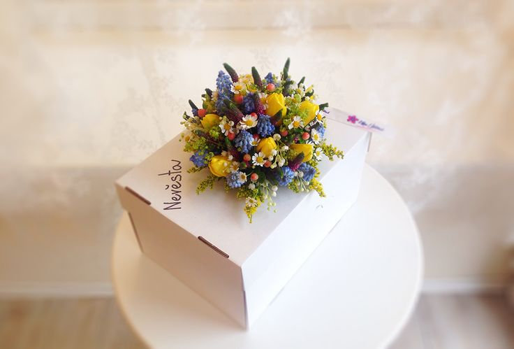 Bright, spring bridal bouquet with tulips, tanacetum, myosotis, veronica and alchemila by Klara Uhlirova