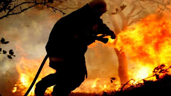 Firefighters battling deadly fires. (Environmental)