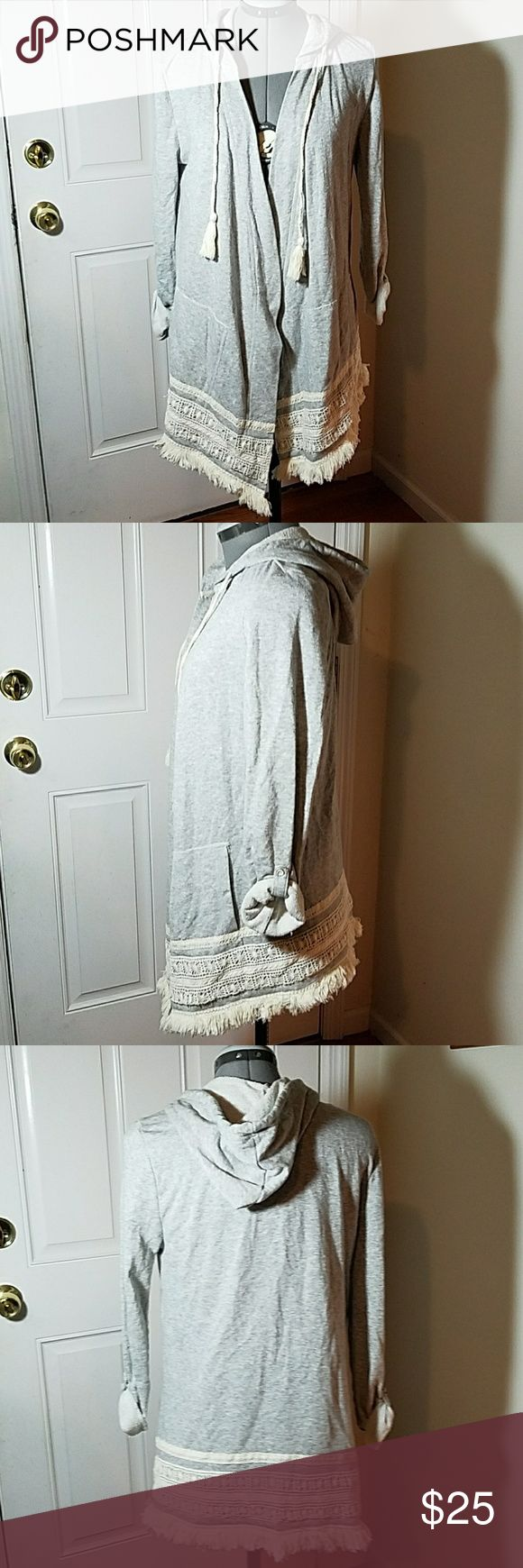Democracy Boho Gray Fringed Hooded Open Jacket S This open jacket is the perfect piece to complete any casual ensemble!? Darling cream lace and fringe adorn the hemline.? It has a hood with a drawstring tie.? There are side pockets in front.? The sleeves have a buttoned rolled effect.? Super soft!  - 63% cotton/ 37% polyester  - Machine wash  - Imported democracy  Jackets & Coats Utility Jackets