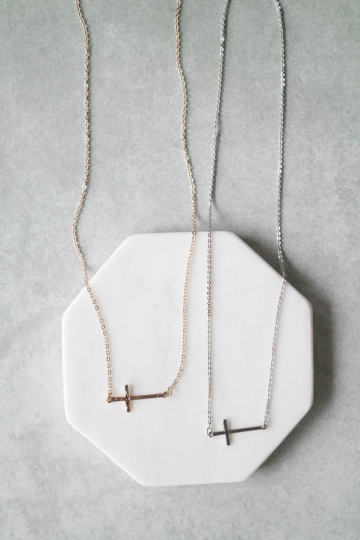 "This delicate cross necklace is perfect for everyday wear. Details: - 18"" long - Plated metal - Lobster clasp closure"
