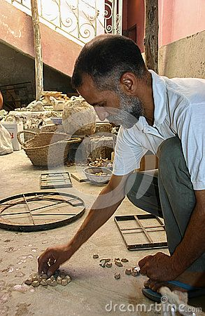 Artisan creates a ceramic project in his workshop in Fez - Morocco.