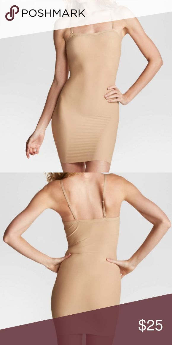 NWT Spanx Assets Convertible Nude Slip Sz Small Brand new with tags Spanx slip. Never been worn, bought a bunch of these at a going out of business sale. Size small SPANX Intimates & Sleepwear Shapewear