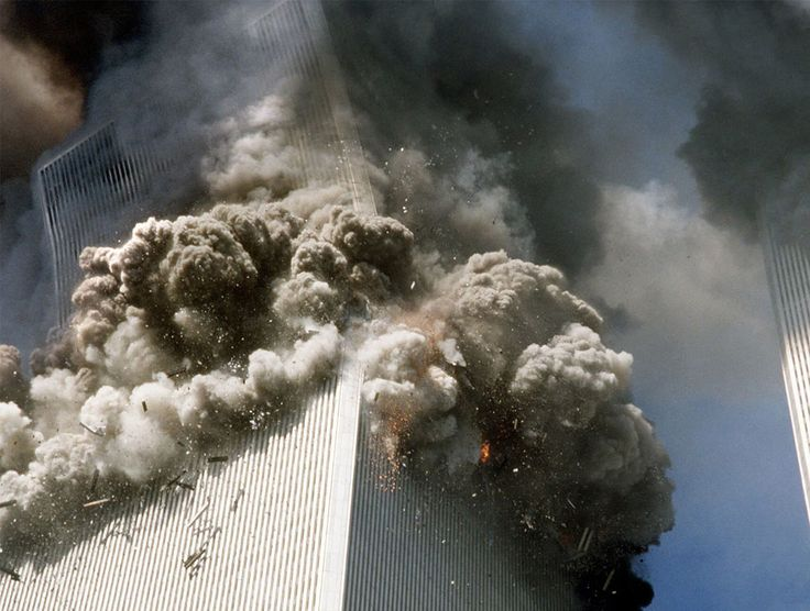 At 9:59 a.m., after burning for 56 minutes, the South Tower of New York's World Trade Center begins to collapse after a terrorist attack on September 11, 2001. (AP Photo/Gulnara Samoilova)