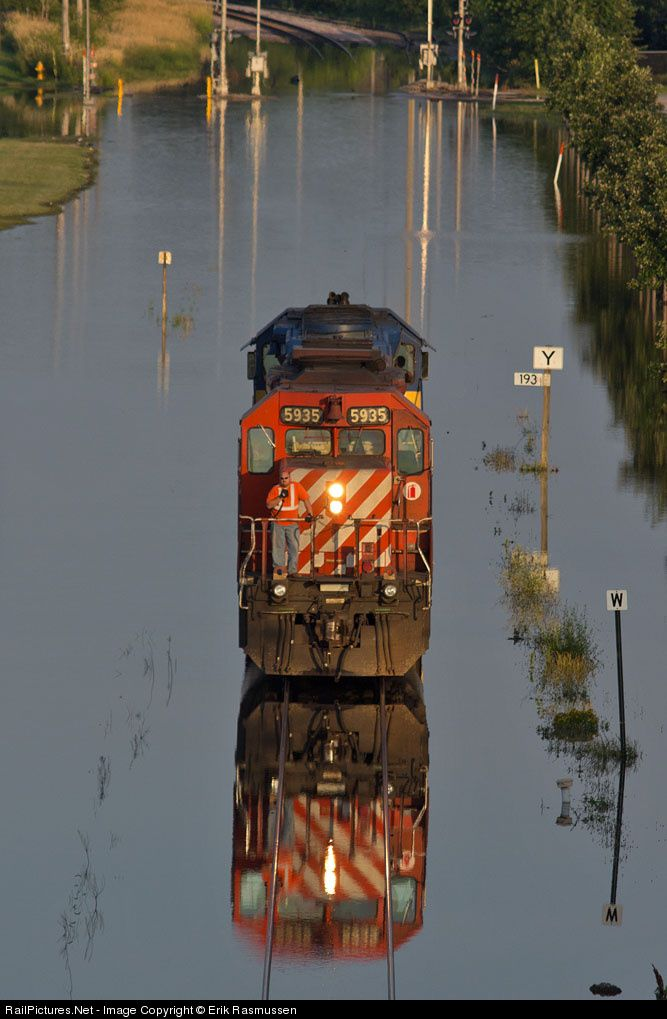 Due to high water from the flooding Mississippi River, the Canadian Pacific decided not to detour but instead push/pull trains through the h...