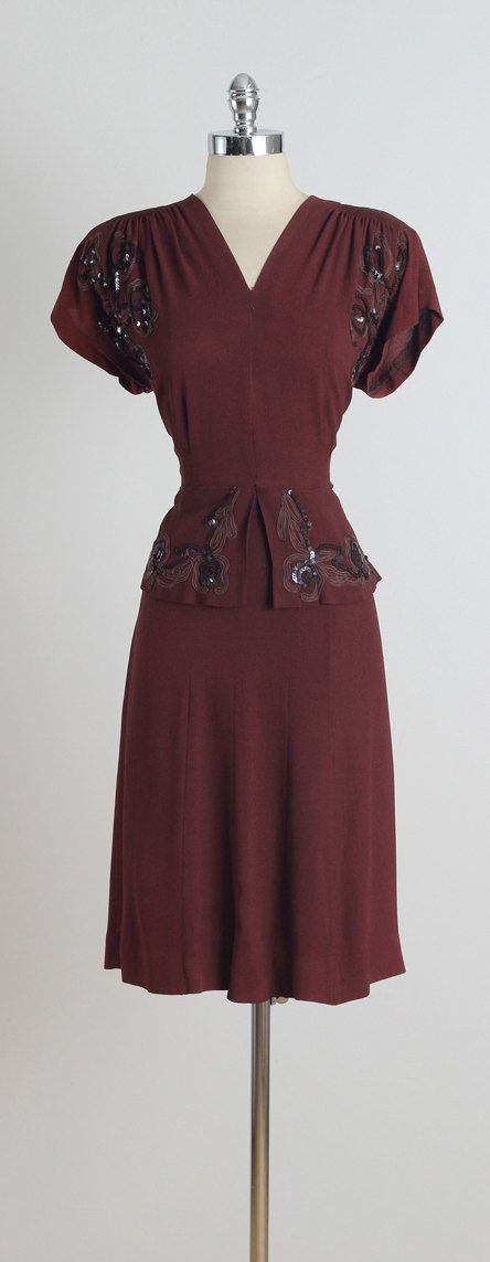 ➳ vintage 1940s dress * maroon rayon crepe * built in shoulder pads * ribbon & sequin floral accents * metal side zipper condition | excellent fits like xl/xxl dress length 41 bodice 16 bust 42 waist 34 hem allowance 2 ➳ shop http://www.etsy.com/shop/millstreetvintage?ref=si_shop ➳ shop policies http://www.etsy.com/shop/millstreetvintage/policy twitter | MillStVintage facebook | millstreetvintage instagram | millstreetvintage 5223/1527