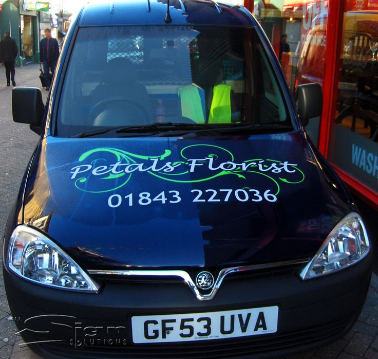 Petals Florist in Margate vehicle livery design uses a handwritten styled font and the colours blue and white. The vivid green swirl stands out on the dark blue colour of the van and has all of the necessary information, such as address, website, social media, awards Petals Florist has won and, Local and National delivery.