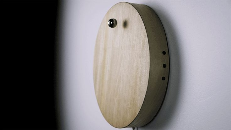 Created by Flyte, STORY is a clock featuring a levitating sphere that orbits around a wooden base, counting the hours, minutes or even years.