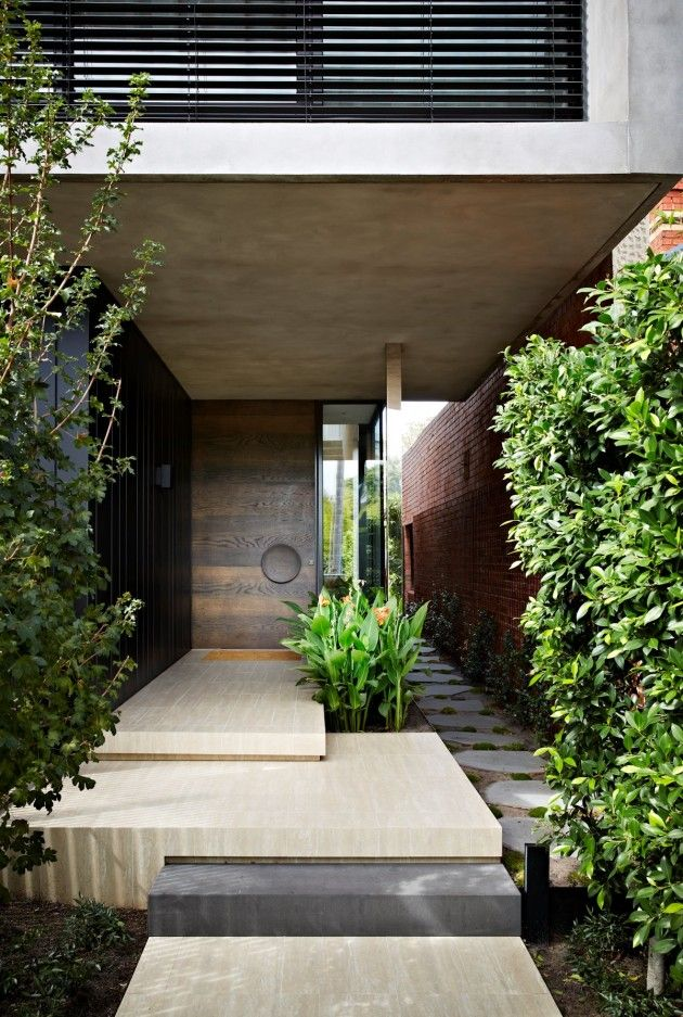 Clever, contemporary use of differentiated pavers to mark step changes and path types in a narrow urban garden design.