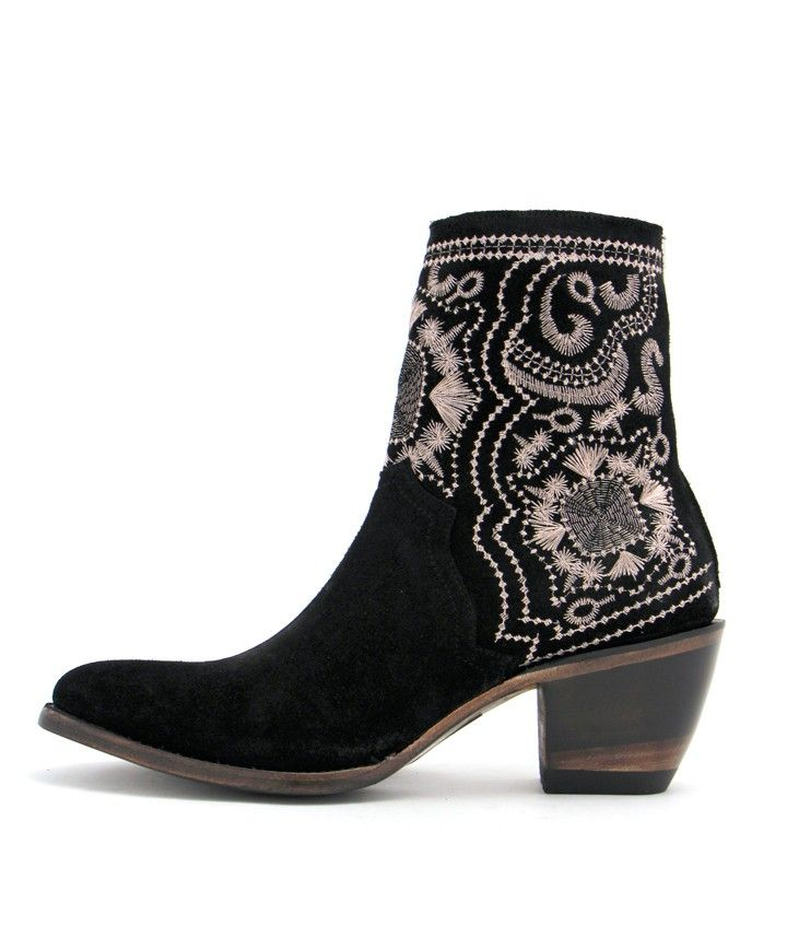 A great staple bootie! This bootie from Yippee Ki Yay is constructed from rich black suede accented with a stylish rose gold stitching. Perfect for a night out on the town! 7